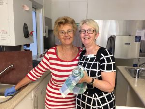 Photo of Stella and Jean on kitchen duty