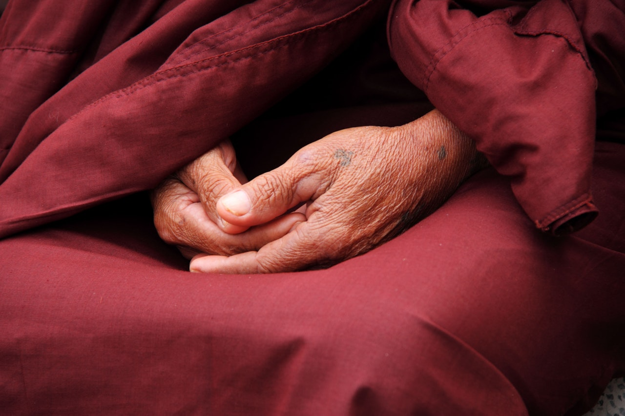Buddhist hands resting